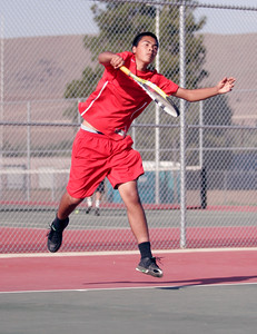 Lindsay  High tennis No. 2 seed, Arturo Corona, serves against Woodlake on Thurdsay, March 20, 2014.
