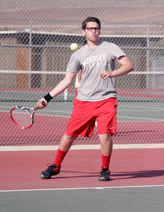 Lindsay Cardinal Tennis No. 1 seed David Soltero hits a forehand against Woodlake on Thursday, March 20th.
