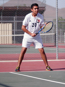 Woodlake Tiger tennis player, Baldamir Sanchez, gets ready to return serve against Lindsay.