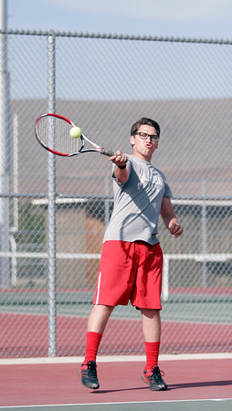 Lindsay High's David Soltero returns a serve against Woodlake on March 20,  2014.