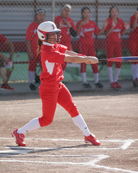 Lindsay Cardinal OF Destiny Garcia takes a swing during their game against Woodlake on Friday.