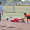 Lindsay's Emily Rojas is safe at second during a pick off play. The Cardinals hosted the Woodlake Tigers on Friday, March 21, 2014.