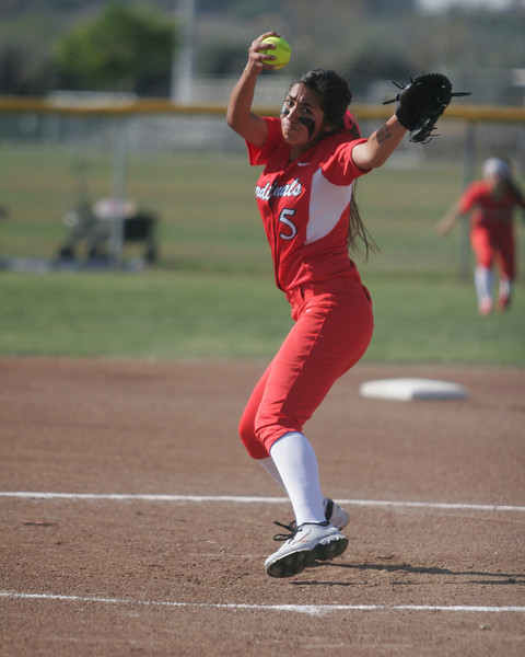 Lindsay Cardinal pitcher Lina Padilla winds up against the Woodlake Tigers on Friday, March 21, 2014.