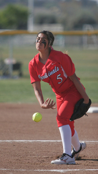 Lindsay Cardinal pitcher Lina Padilla throws a strike against Woodlake on Friday.