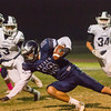 Farmersville Aztec Wide Receiver Skyler Morris (13) hauls in a pass during  Farmersville's homecoming game against the Yosemite Badgers. The Aztecs would lose a hard fought battle by a 35-33 score to the undefeated Badgers.
