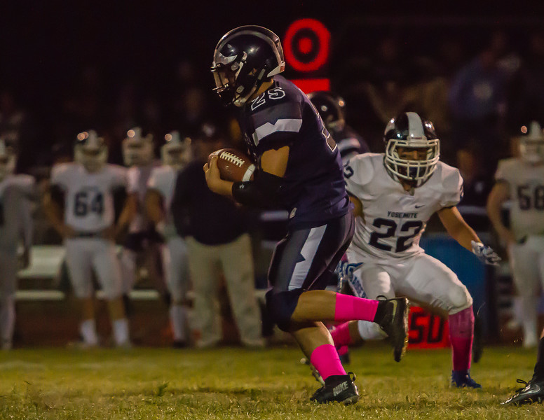 Farmersville RB David Contreras (25) rushes the ball against  the Yosemite Badgers. Contreras rushed 13 times for 21 yards in the Aztec's 35-33 loss to the Yosemite Badgers.