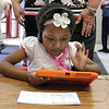 Pre School student Neytiri Jeffreys, 5, plays with the Footsteps2Brilliance app on a tablet at the Fitchburg Flourishes early learning literacy summit on Thursday morning, May 4,2017 held at Fitchburg High School. SENTINEL & ENTERPRISE/JOHN LOVE