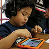 Pre School student Christopher Gonzalez-Hernandez, 4, plays with the Footsteps2Brilliance app on a tablet at the Fitchburg Flourishes Early Learning Literacy summit on Thursday morning, May 4,2017 held at Fitchburg High School. SENTINEL & ENTERPRISE/JOHN LOVE
