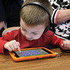 Pre School student Roy DeHart III, 3, plays with the Footsteps2Brilliance app on a tablet at the Fitchburg Flourishes Early Learning Literacy summit on Thursday morning, May 4,2017 held at Fitchburg High School. SENTINEL & ENTERPRISE/JOHN LOVE