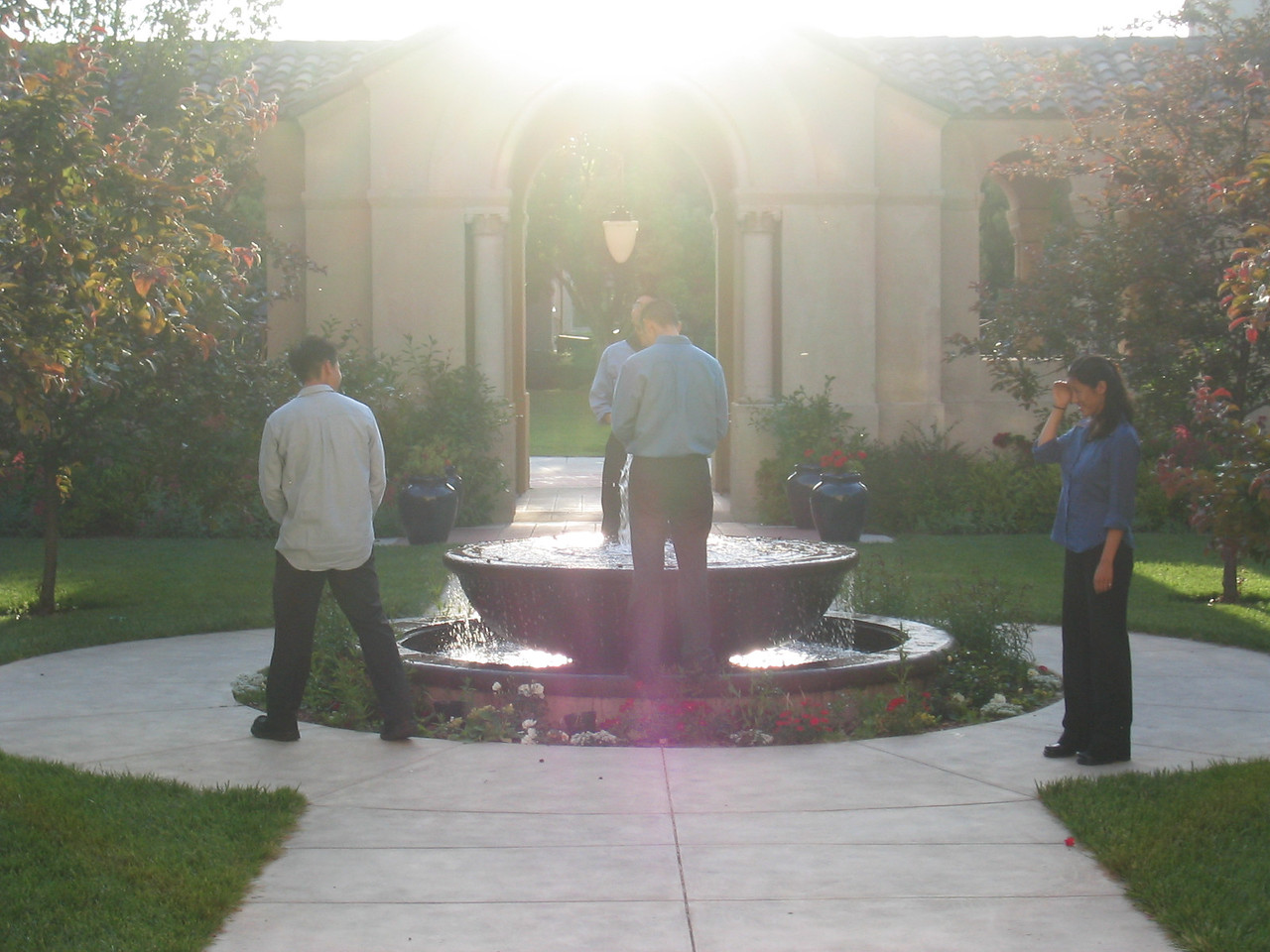 Jonathon and Ben pee in Stanfurd fountain while Chris fertilizes shrub and Joyce looks on