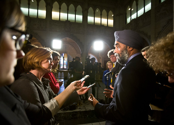 National Defence Minister Harjit Sajjan is scrummed by members of the National Press Gallery after Question Period in the House of  Commons, Thursday, February 4, 2016 in Ottawa. Photo/Fred Chartrand