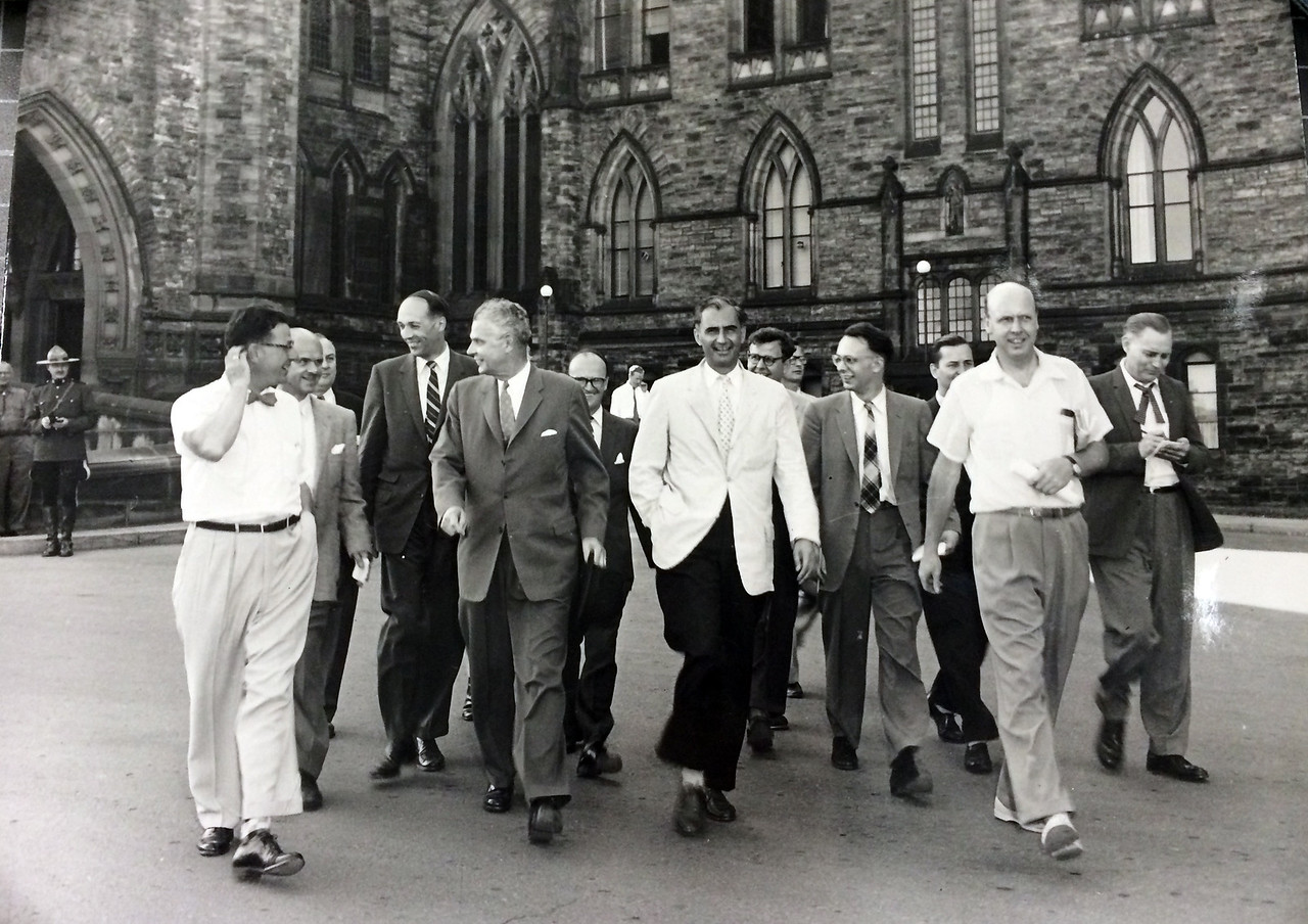 Prime Minister John Diefenbaker, walks with newsmen on Parliament Hill. Date unknow Library and Archives/ Victor Mackie Fonds