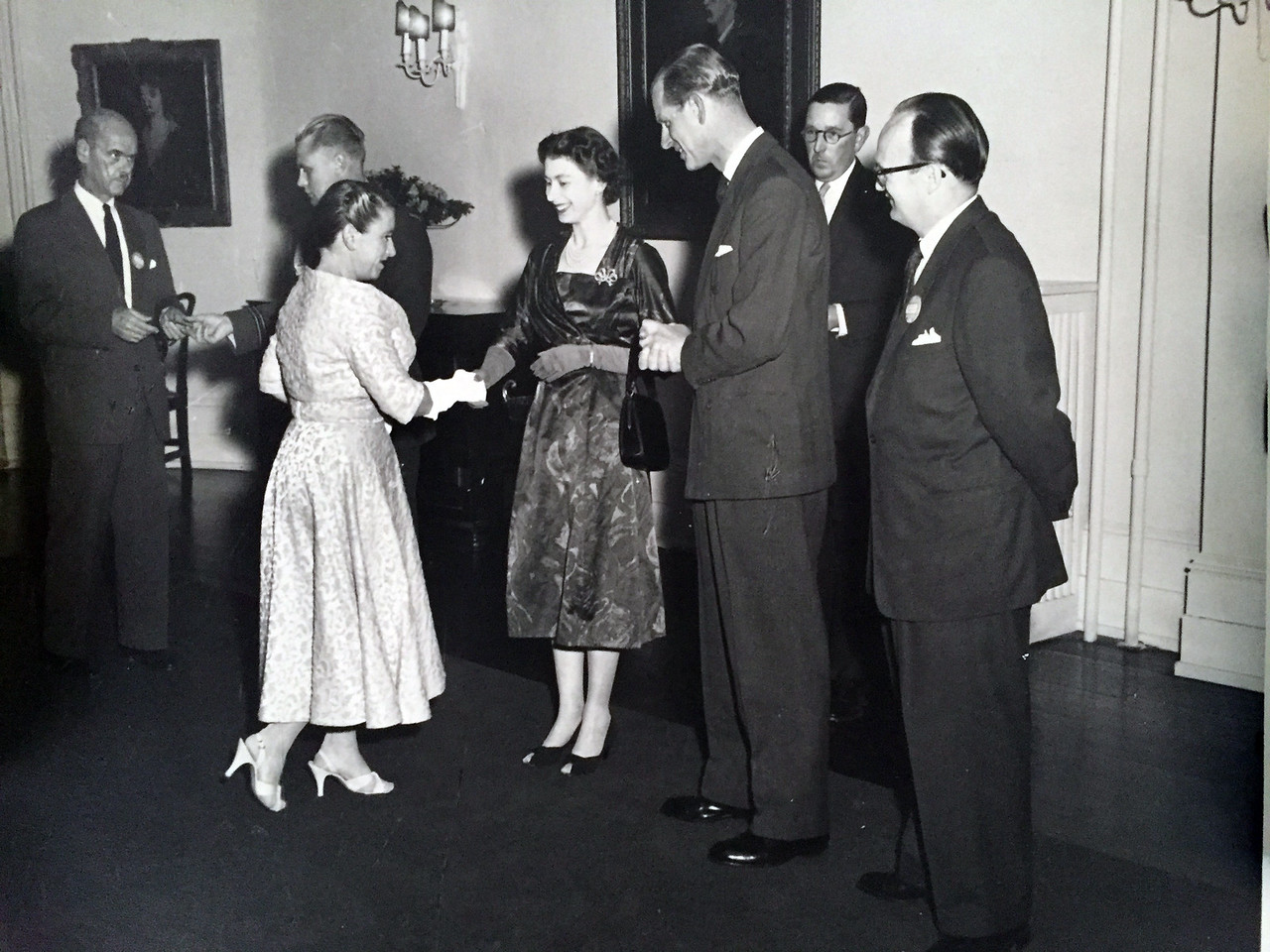 James McCooke, Jean Mackie (curtseying)to Queen Elizabeth, and Victor Mackie (then president of the gallery) beside Prince Phillip. (Photo courtesy of Richard Mackie)undated