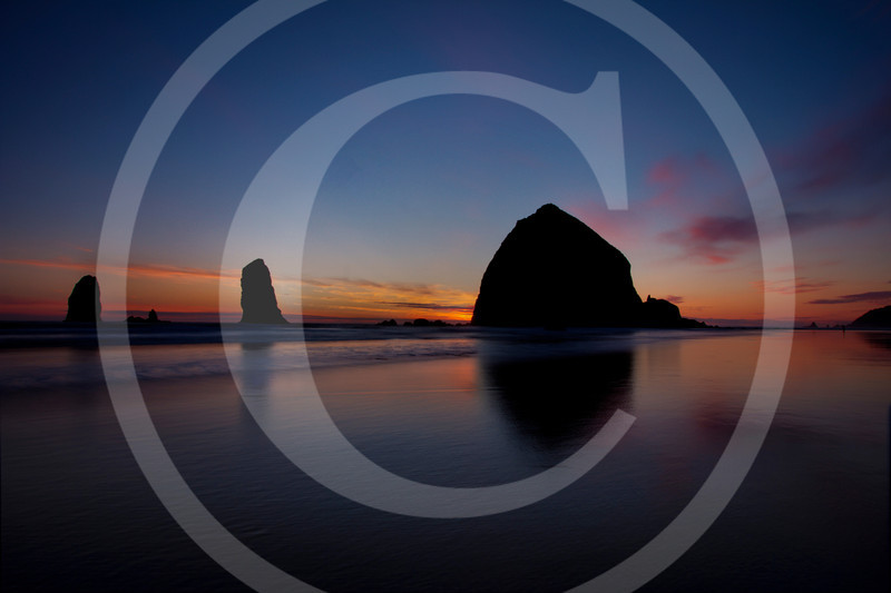 This week is a serene sunset shot from the iconic Cannon beach, Oregon. If you had been following my work, you would have noticed similar shots from past. Actually this was shot on the same day as the earlier shared shot. Indeed these two shots are just 15 minutes and probably 100 feet apart. The light during the golden hour is ever changing and can make all the difference. Also you will be surprised how a few steps can alter the composition of the shot, drastically and dramatically. So the next time when you are shooting, don't just play with that zoom, make an effort to take a couple of extra steps :)<br /> <br /> I like the other shot for the composition (may be because it is more close to the rule of third or the golden spiral) and this one for capturing the serene mood of the evening. Which one do u like, do share below in comments !!!