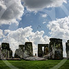 Stonehenge, this time the original<br /> Last week post of Stonehenge replica from Washington, USA brought back memories of my visit to the original Stonehenge located at Wiltshire, UK. This shot is from couple of years back, wish I had been shooting RAW then ! <br /> <br /> As much as I liked the replica here at Washington and the ability to walk around and inside the Stonehenge, you really can't even get close to the experience of the original. Expected to be constructed some where between 3000 BC to 2000 BC, the true meaning of this ancient, awe-inspiring creation has been lost in the mists of time. Was it a temple for sun worship, a healing center, a burial site or perhaps a huge calendar ? How did they manage to carry the mighty stones, with only the most primitive of tools. Surrounded by all the mystery, Stonehenge never cases to impress.