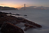 Golden Gate Sunset - San Francisco California<br /> <br /> The late evening sun sets behind the Golden Gate Bridge.