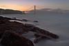 Golden Gate Sunset - San Francisco California<br /> <br /> The late evening sun sets behind the Golden Gate Bridge.