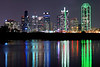 Dallas Skyline Reflection<br /> <br /> The buildings of the Dallas skyline create bleeds of color in their reflection on the water.