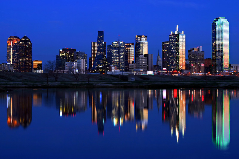 Dallas Sunset Reflection - Dallas Texas<br /> <br /> The setting sun creates beautiful colors on the buildings of the downtown Dallas Skyline, creating a perfect reflection.