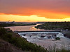 Warm Evening Sunset - Great Falls Montana<br /> <br /> Color explodes from the sky during this sunset over the Missouri River in Great Falls.  Black Eagle damn is seen below.