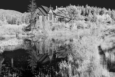 """Chapel""  Estes Park, CO I really love how infrared light changes the dynamics of a scene.  Plants glow bright white, and non reflective sources turn black.  This creates a beautiful contrast in a scene.  I converted this to Black and White, as I feel it works well with an infrared scene.  Technical Details: Shot with an IR modified Canon 10D and Canon 50mm lens at F22, 1/60  seconds and ISO 100.  Mosaic image created from 15 source images."