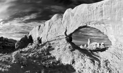 """Turret Arch""  Arches National Park, UT I really love how infrared light changes the dynamics of a scene.  Plants glow bright white, and non reflective sources turn black.  This creates a beautiful contrast in a scene.  I converted this to Black and White, as I feel it works well with an infrared scene.  Technical Details: Shot with an IR modified Canon 10D and Canon 50mm lens at F22, 1/60  seconds and ISO 100.  Mosaic image created from 15 source images."