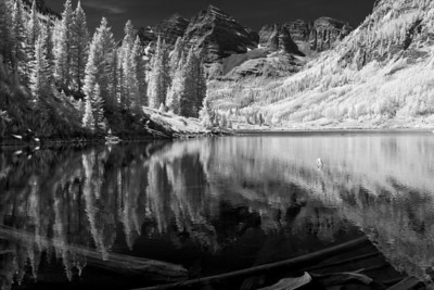 """Bells Reflection""  Maroon Bells National Recreation Area, CO  I really love how infrared light changes the dynamics of a scene.  Plants glow bright white, and non reflective sources turn black.  This creates a beautiful contrast in a scene.  I converted this to Black and White, as I feel it works well with an infrared scene.  Technical Details: Shot with an IR modified Canon 10D and Canon 50mm lens at F22, 1/60  seconds and ISO 100.  Mosaic image created from 15 source images."