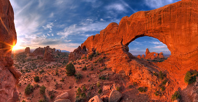 """Turret Arch""  Arches National Park, UT It is possible to capture Turret Arch through The North Windows arch, creating this amazing scene.  To get to this location, you have to climb through the North Window and scramble up some rocks.  This is one of the best views within Arches National Park, in my opinion. Technical Details: Shot with a Canon 5d Mk2 and a Canon 20mm prime lens at F16.  Bracketted images stitched and merged to create a wider dynamic range."