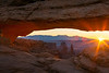 """""""Mesa Arch Sunrise"""" <BR><BR> Canyonlands National Park, UT <BR><BR> Mesa Arch is an iconic location in Canyonlands National Park.  On any given morning, you can expect tons of photographers there capturing the sunrise.  On this particular morning, I arrived a full hour before sunrise to secure my spot in front of this small arch.  It's a beautiful thing to experience.<BR><BR> Technical Details: Shot with Canon 10D and Canon 20mm lens at F10 and 1/8.    Panorama created from 6 horizontal shots. <BR><BR> <br><center><a href=""""javascript:addCartSingle(ImageID, ImageKey)""""><img src=""""/photos/604338366_ecXJp-M.gif"""" border=""""0""""></a></center>"""