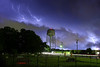 Beware Bobcat Country (2005) - Lightning spiders across the sky over the town of Elgin, Texas as a summer thunderstorm moves through the area.