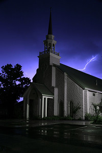 Church Lightning (2004) - A bolt of lightning streaks over a small Church in the town of Elgin, Texas.