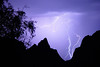 """Lightning Through the Window (2003) - An intense summer thunderstorm sends lightning bolts through """"The Window"""" in the Chisos mountains of Big Bend National Park in Texas."""