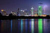 Towers of Light (2002) - Lightning strikes near the highrise buildings of downtown Dallas, Texas as the skyline is reflected in a small nearby lake.