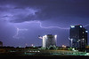 Lightning Towers (2002) - Lightning streaks horizontally across the sky during a small summer thunderstorm over the town of Richardson, Texas.