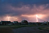 Farm Lightning (2007) - Lightning streaks through the rain near the town of Choteau, Montana as a summer thunderstorm moves across the Montana plains.