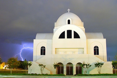 Richardson Church Lightning (2004) - Lightning forks into the ground as a storm moves away from this small church in Richardson, Texas.