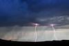 Rocky Mountain Front Range Lightning (2007) - A small summer thunderstorm sends lightning streaking over the front range of the Rocky Mountains near the town of Choteau, Montana.