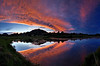 """""""Sky Fire"""" <BR><BR> Estes Park, CO <BR><BR> This is an image from my family vacation to Estes Park, Colorado in 2010.  I wasn't planning on shooting this evening, as we had just arrived and were still getting setup and unpacked.  However, as the sky unfolded out the window of our rental house, I knew I needed to shoot it.  I was able to quickly scamper down the hill from our place to a small lake and capture this image.  The colors were fantastic, and only last for a few minutes. <BR><BR> Technical Details: Shot with Canon 30D and Canon 10-22mm lens at F16 and 1/8.    Panorama created from 24  vertical bracketted shots. <BR><BR> <br><center><a href=""""javascript:addCartSingle(ImageID, ImageKey)""""><img src=""""/photos/604338366_ecXJp-M.gif"""" border=""""0""""></a></center>"""