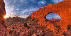 """Turret Arch"" <br><br> Arches National Park, UT<br><br> It is possible to capture Turret Arch through The North Windows arch, creating this amazing scene.  To get to this location, you have to climb through the North Window and scramble up some rocks.  This is one of the best views within Arches National Park, in my opinion.<br><br> Technical Details: Shot with a Canon 5d Mk2 and a Canon 20mm prime lens at F16.  Bracketted images stitched and merged to create a wider dynamic range."