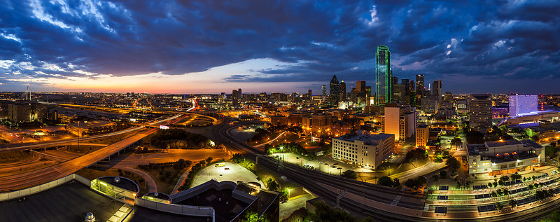 """Big D"" <br><br> Dallas, TX<br><br> There is something incredibly peaceful about being on top of a building overlooking a busy city as the sweet light of evening comes on.  Even with all the hustle, bustle and noise of the city places can be found that offer a breathtaking vantage point. <br><br> Technical Details: Shot with a Canon 5d Mk2 and a Canon 24-70mm lens at F10 and 30 seconds."