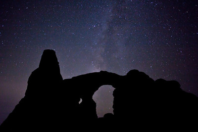 """""""Turret Arch Starscape""""  Arches National Park, UT Turrent Arch is a neat rock formation located near the Windows in Arches Park.  On this evening, I had tried shooting the windows, but wasn't pleased with the results.  However, the Milky Way was nicely lined up with this arch. Technical Details: Shot with Canon 5d mk2 with a Canon 20mm prime lens."""