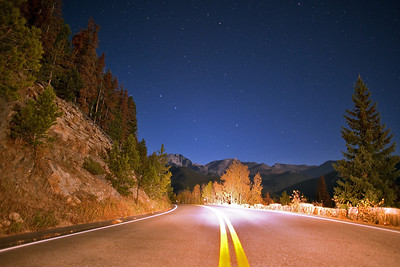 """Trail Ridge Road""  Rocky Mountain National Park, CO  It's amazing how much detail modern cameras can capture when the full moon is out!  In this shot, the moon was rising over my left shoulder, illuminating the scenery in a beautiful light.  The stars were amazing due to the lack of clouds, adding to the scene.  Technical Details: Shot with Canon 5D Mk2 and Canon 20mm lens at F2.8, 20 seconds and ISO 3200."