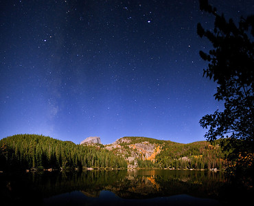"""Bear Lake under the Stars""  Rocky Mountain National Park, CO  It's amazing how much detail modern cameras can capture when the full moon is out!  In this shot, the moon was rising over my left shoulder, illuminating the scenery in a beautiful light.  The stars were amazing due to the lack of clouds, adding to the scene.  Technical Details: Shot with Canon 5D Mk2 and Canon 20mm lens at F2.8, 20 seconds and ISO 3200."