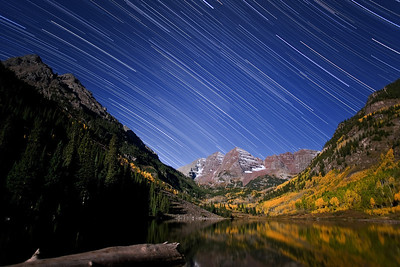 """""""Maroon Bells Star Scape""""  Maroon Bells National Recreation Area, CO  Stars streak across the night sky in this long exposure captured in the Maroon Bells National Recreation Area.  Technical Details: Shot with Canon 5d mk2 with a Canon 20mm prime lens at F2.8 and 90 seconds.  Image created from around 2 hours total of exposures."""