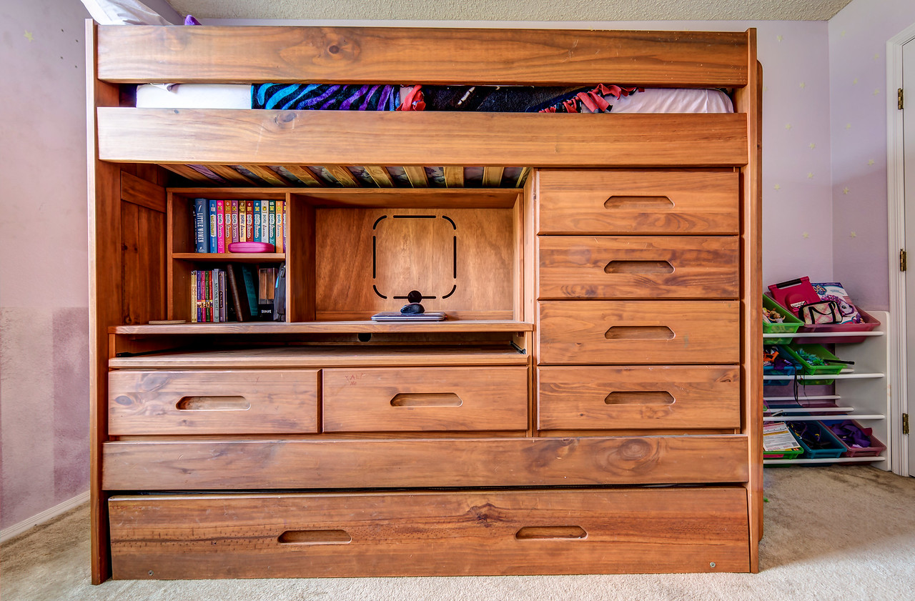 6 drawers, desk, twin loft bed, twin trundle bed, pass through storage behind.