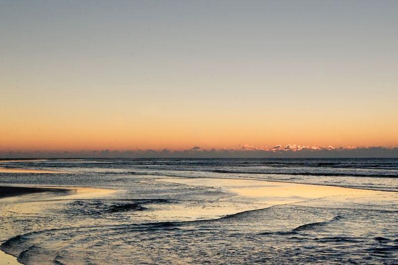 the sun is settin to rise over the ocean, Sullivan's Island.