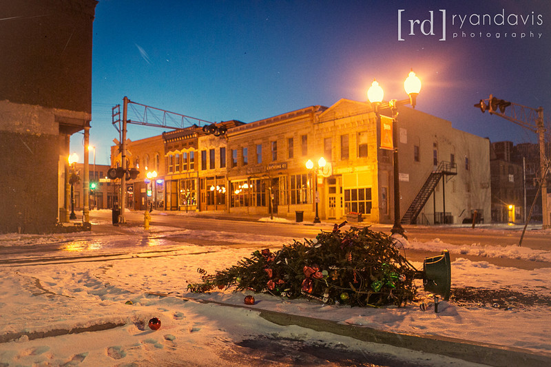 A Christmas tree lays on the ground early on New Year's Day 2013 in downtown Rockford, across from Carlye Brewing. I guess the party's over, folks! Photo by Rockford photographer Ryan Davis.