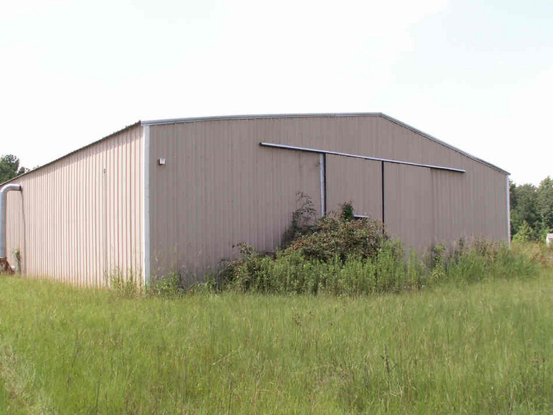 Approximately 10 acres located within 1 1/2 miles of I-20 & I-95 (you can go anywhere from here!!). Two (approximately) 60' x 90' metal buildings wired for 3 phase high voltage, a two story concrete block building (approximately 30' x 30'). Buildings have concrete flooring. Two septic tanks on site, one commercial, one residential. County water!! Great dog kennel (never used!) has inside and outside facility for dogs. A pond was started but not completed, finish it to your liking! Includes wooded acreage! Easy access and plenty of room for tractor trailers.  This is a good general listing. Interested persons should call for details and price. Call Cary at 843-861-0025 or Troy at 843-861-0803. Priced to sell!