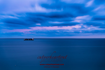 The thing I like best about this photo is that the sea and sky are silky from the long exposure while the container ship was amazingly still!