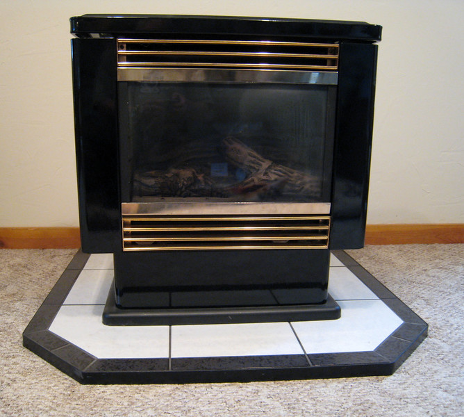 Front view of Pacific Energy Mirage gas stove for sale. Included is the pedestal/base for it.